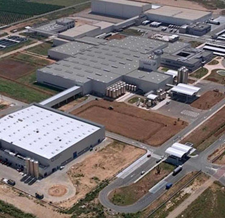 Aerial view of plastic bottling and warehouse facilities